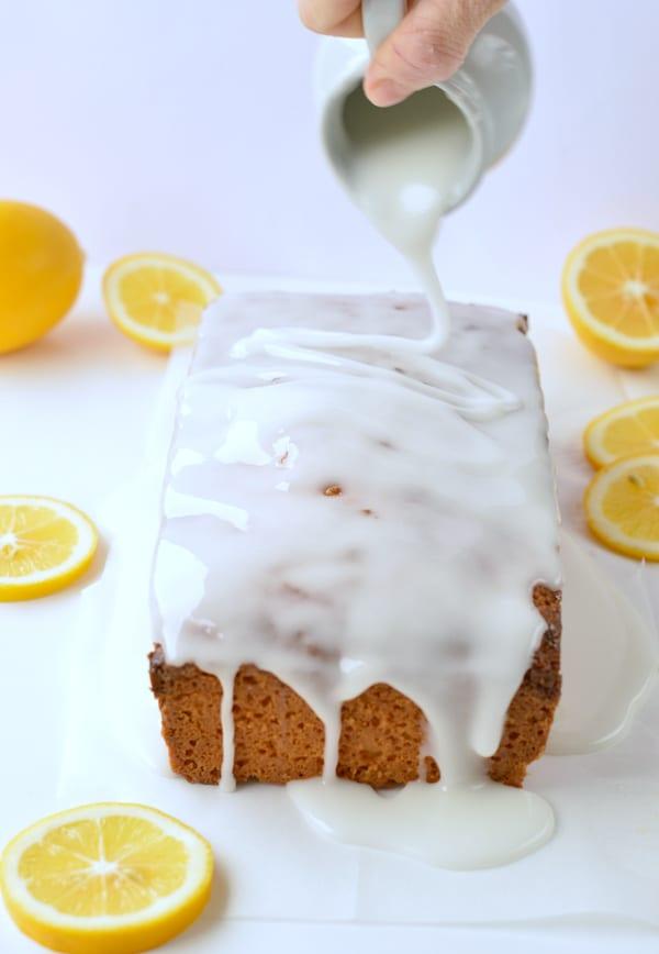 Pouring glazing on the keto lemon pound cake