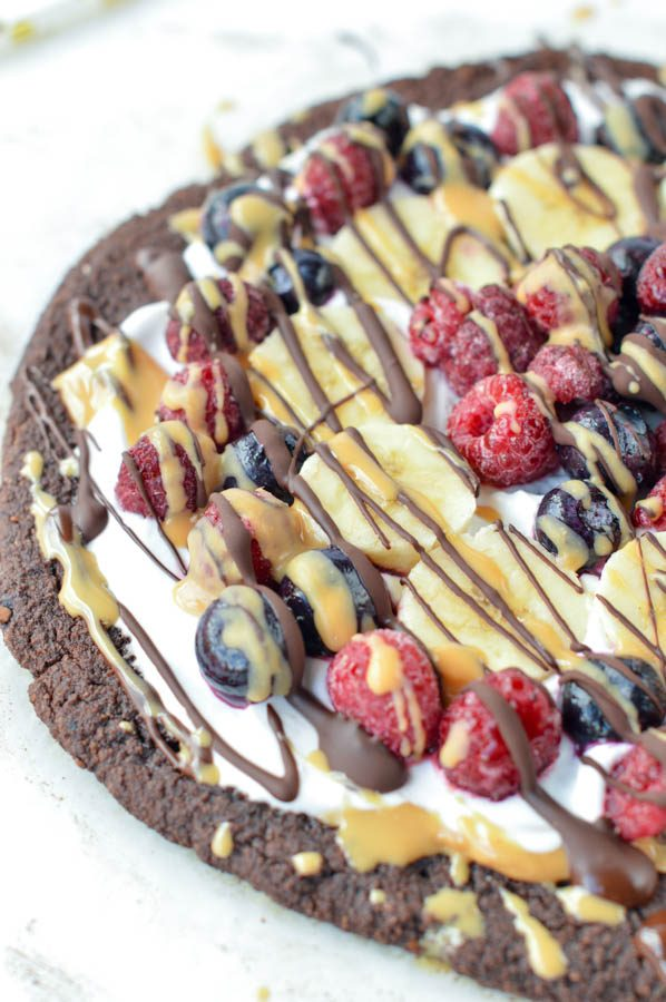 Healthy Paleo Brownie Fruit Pizza with almond meal, coconut flour and chia seed. Egg free, dairy free and gluten free. A fudgy chocolate dessert with delicious fresh toppings: coconut yogurt, peanut butter and fruits.