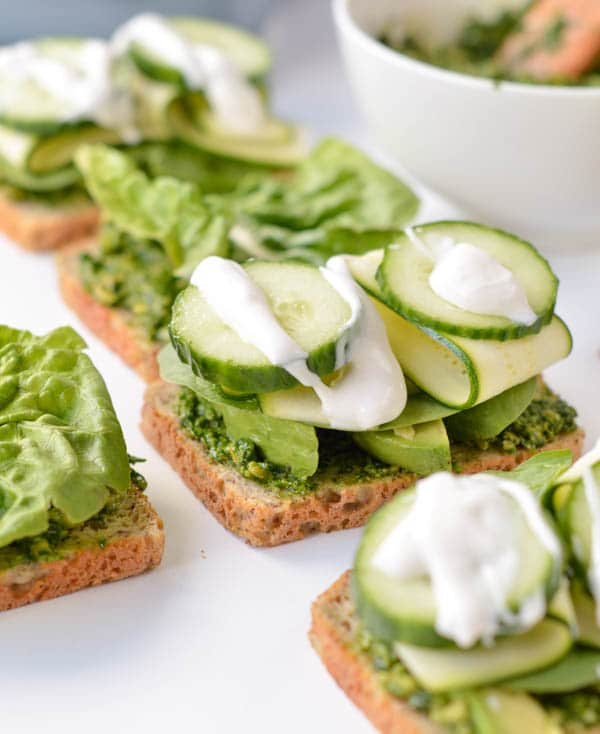 Healthy Vegetarian pesto sandwich. A green goddess paleo sandwich made with homemade paleo cashew pesto, avocado, spinach, cucumber and zucchini and a drizzle of coconut oil mayonnaise