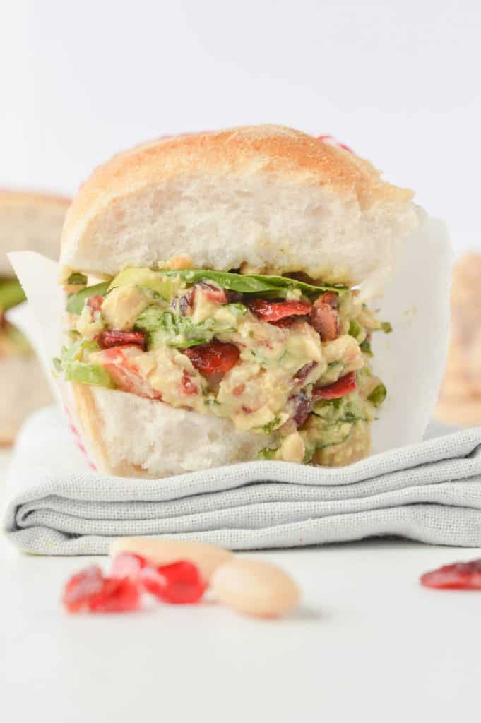White Bean Sandwich with Cranberries, Walnuts and Scallions. An healthy vegan gluten free sandwich with Christmas colors perfect to bring on the beach for post Christmas detox lunches.