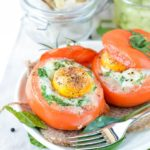 Low carb egg stuffed tomatoes with spinach and cheese. Delicious dinners or healthy breakfast recipes 100% gluten free and keto friendly.