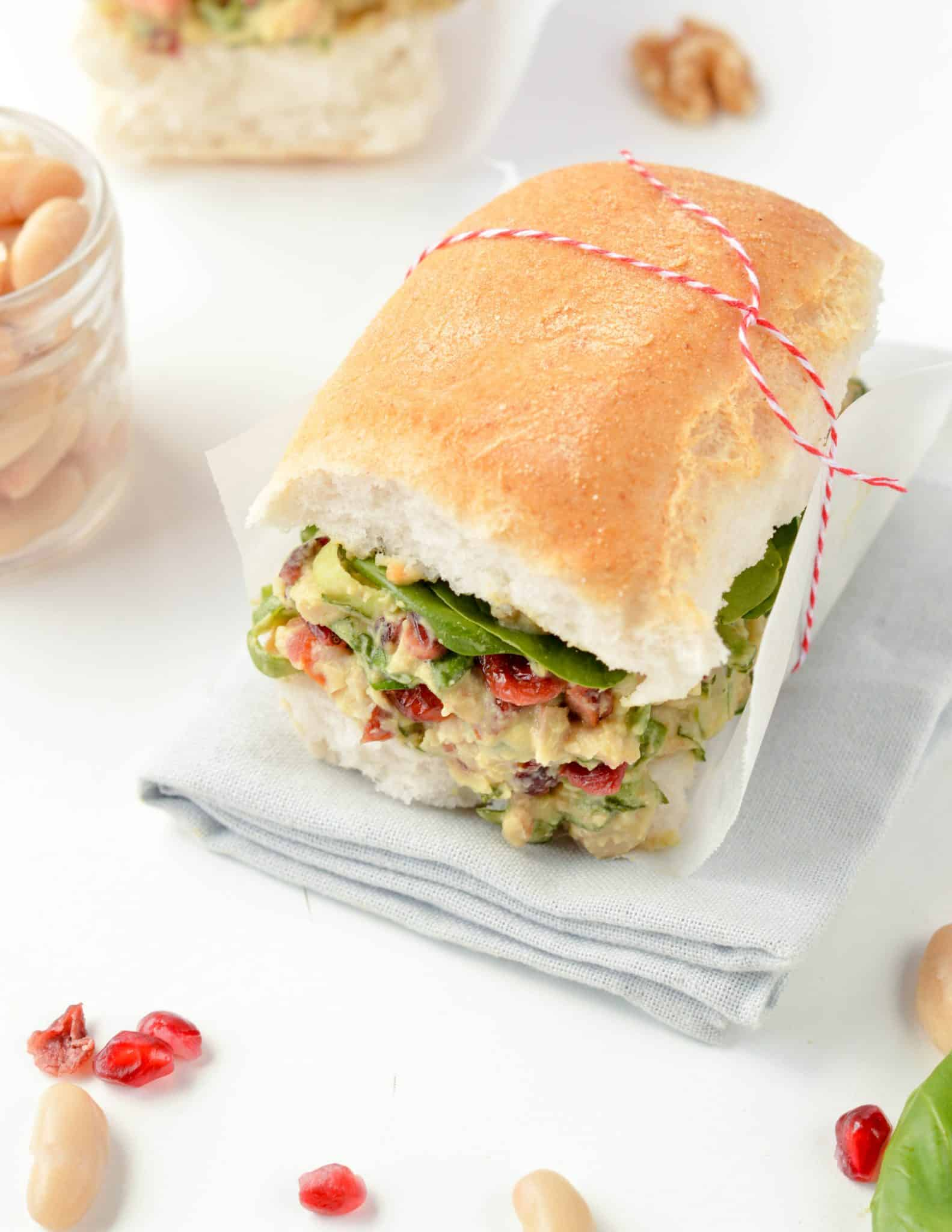White Bean Sandwich with Cranberries, Walnuts and Basil in a creamy Tahini Mustard Dressing. An healthy vegan gluten free sandwich with Christmas colors perfect to bring on the beach for post Christmas detox lunches.