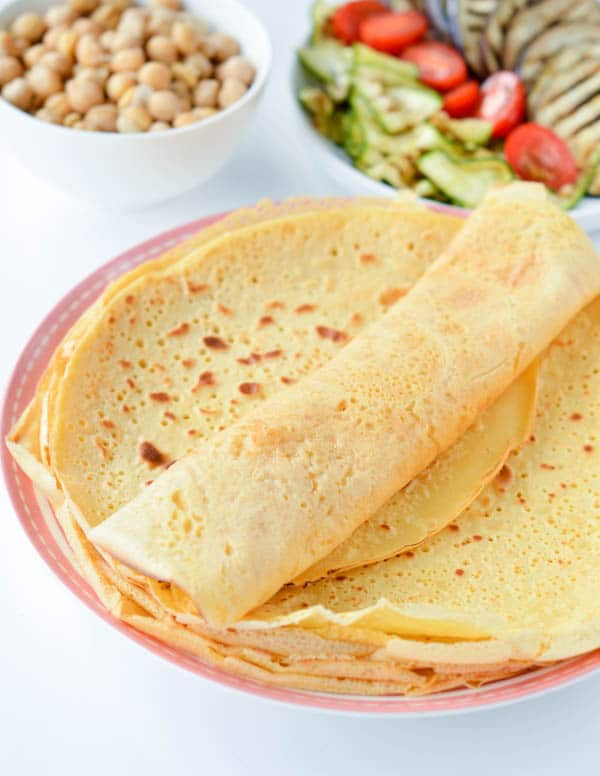 Chickpea crepes are delicious thin vegan and gluten free protein wraps made with only 3 ingredients: garbanzo bean flour, water and salt. An easy, healthy blender recipe perfect for a savory crepes for breakfast. Delicious with mushrooms, spinach or grilled vegetables. #vegan #chickpea #garbanzo #wraps