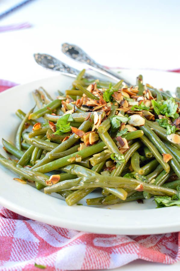 AUTHENTIC FRENCH GREEN BEAN recipe from my mum sauteed in olive oils with almonds, shallots, garlic and deglazed with lemon juice. An easy side dish for Holidays, Christmas or Thanksgiving. Dairy free + gluten free + vegan.