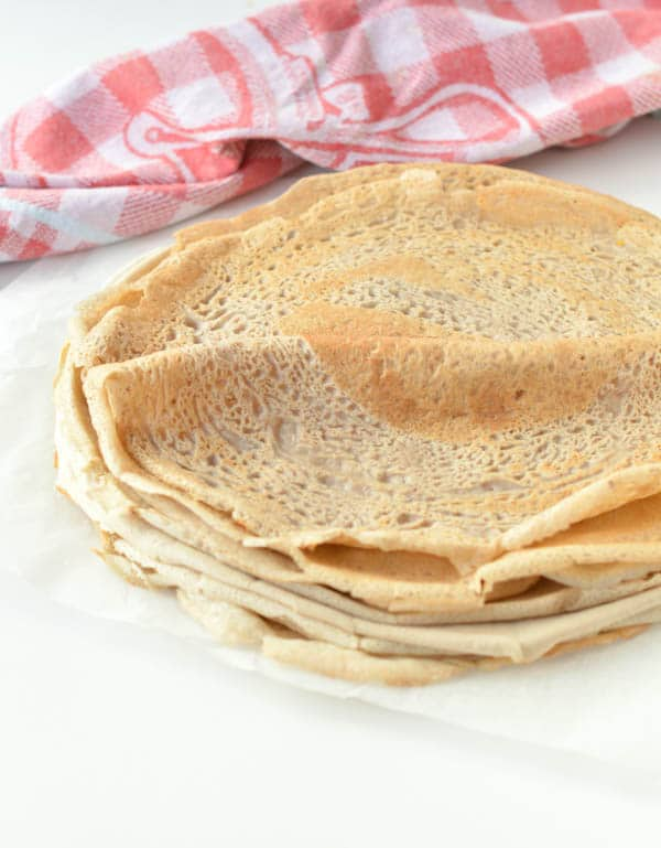 French Buckwheat Crepes are gluten free savory crepes made of 100% buckwheat flour, water, egg and salt. It is an easy and healthy 4 ingredients crepes recipe with moist center and crispy borders that French people love to eat for dinner stuffed with spinach and mushroom or ham and cheese.