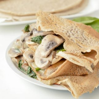 French Buckwheat Crepes are gluten free savory crepes made of 100% buckwheat flour. An easy, healthy 4 ingredients savory crepes recipe to stuff with ham and cheese or spinach and mushrooms. #crepes #buckwheat #glutenfree