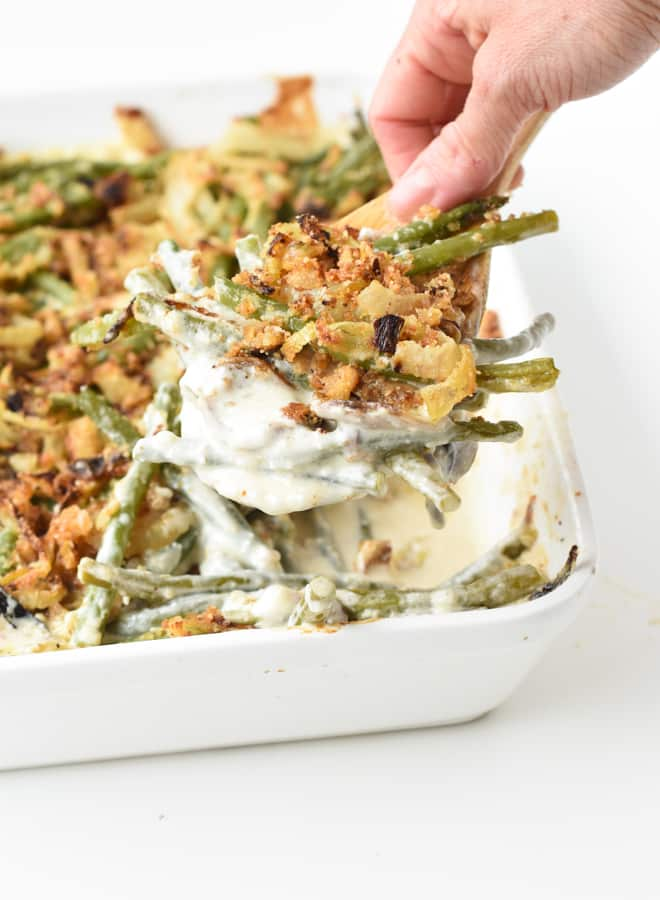 Spoon of green bean and creamy crispy onions from the casserole