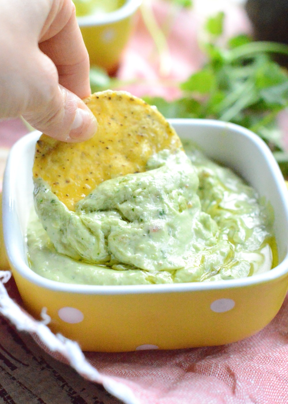 Simple avocado dip for chips only 6 ingredients with cilantro, tahini and olive oils. A creamy simple guacamole recipe perfect to dip tortilla chips.