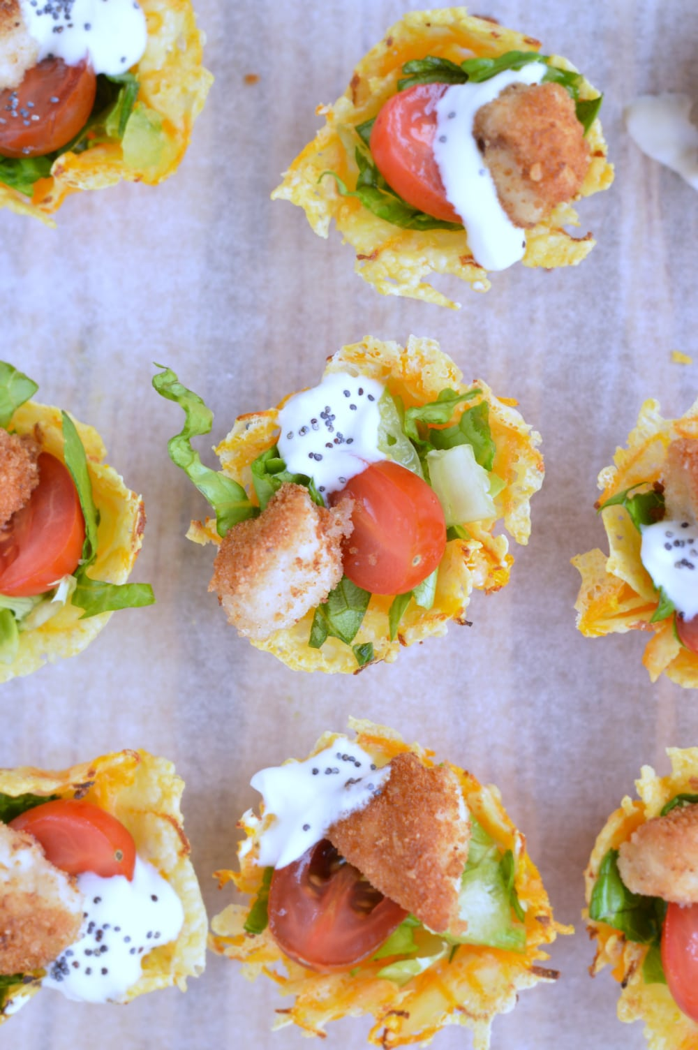 caesar salad appetizers in carrot parmesan cup