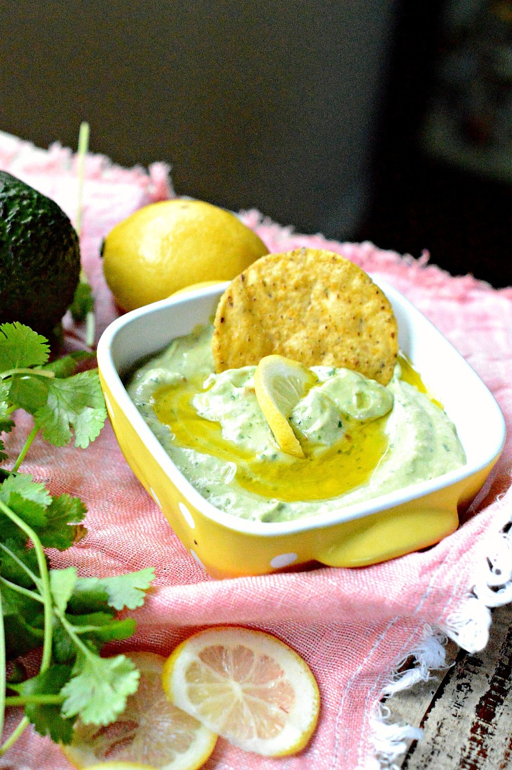 Simple avocado dip only 6 ingredients with cilantro, tahini and olive oils. A creamy simple guacamole recipe perfect to dip tortilla chips.
