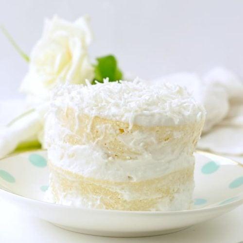 KETO COCONUT FLOUR MUG CAKE easy, low carb, healthy a keto vanilla mug cake with coconut frosting 4.9g net carbs #ketomugcake #keto #coconutflourmugcake #coconutflour #ketorecipes #easy #healthy #lowcarb #paleo #coconut #vanilla #birthday #microwave #videos #90second