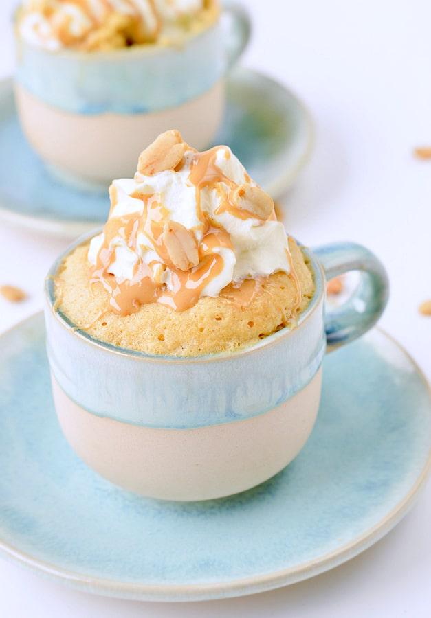 KETO PEANUT BUTTER MUG CAKE with almond flour, unsweetened hipped cream and peanut butter drizzle #keto #mugcake #locarb #glutenfree #ketorecipes #sugarfree