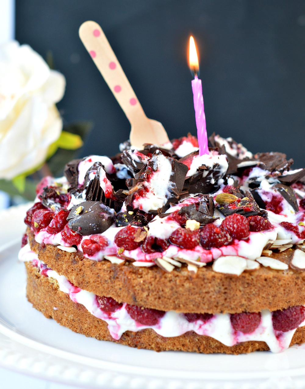 Healthy Sugar free vanilla cake with whipped cream and raspberries. An easy and delicious low carb birthday cake recipe with stevia. Diabetes friendly, gluten free.